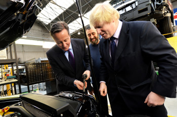 David Cameron and Boris Johnson visited the company which makes the iconic vehicles as plans to build a new factory are announced.