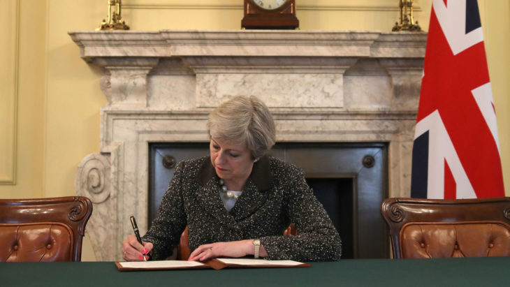 Embargoed to 2200 Tuesday March 28 Prime Minister Theresa May in the cabinet signs the Article 50 letter, as she prepares to trigger the start of the UK's formal withdrawal from the EU on Wednesday.